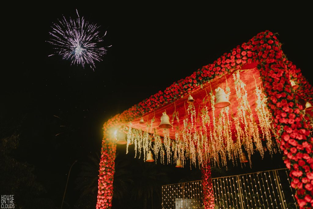 red rose open floral mandap with hanging flowers