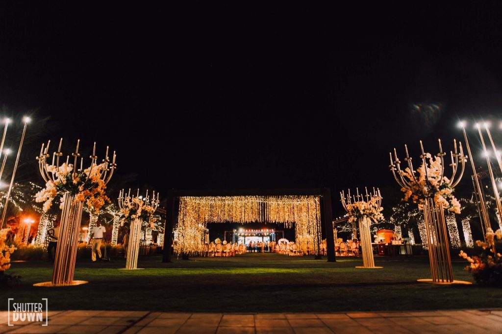 outdoor destination engagement floral decoration with hanging lights in Intercontinental Fujairah Resort