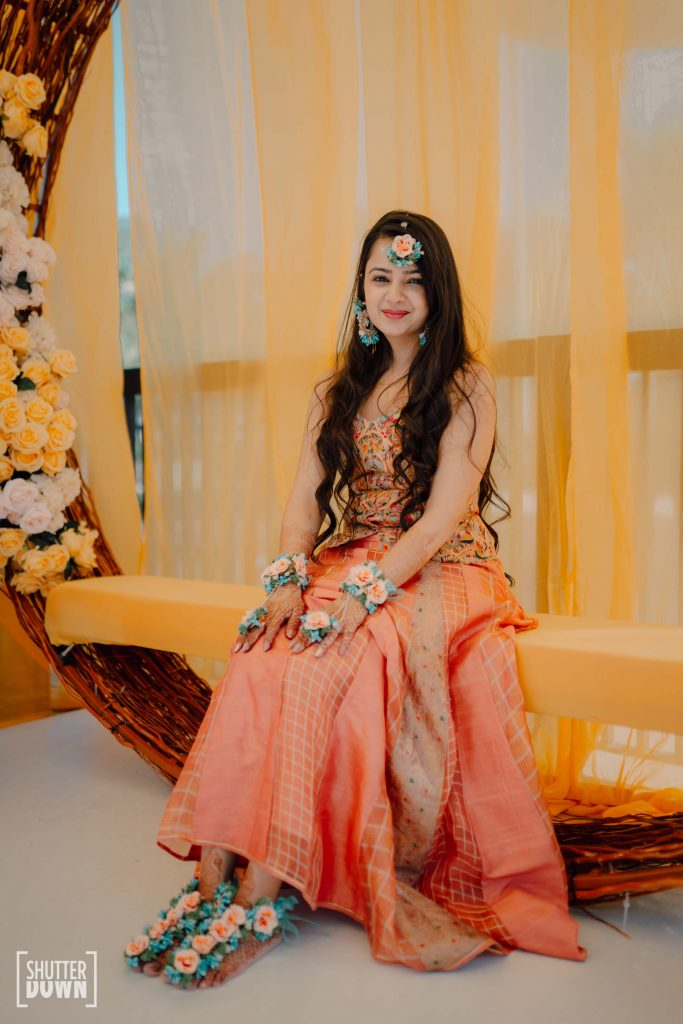 Mrighna's pastel shades of sunrise themed haldi outfit by Ashima & Asit
