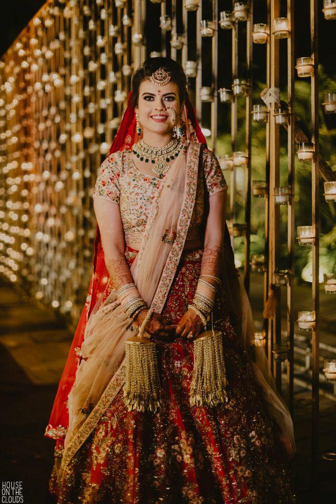 Bride in Pink Red designer bridal dress with pink sheer dupatta