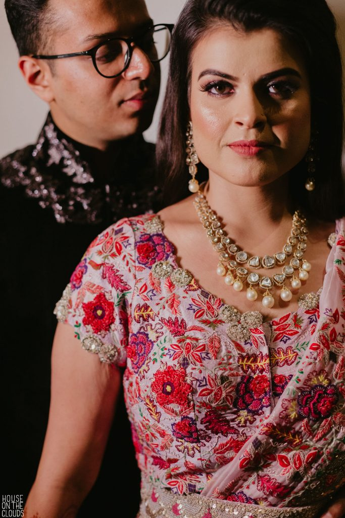 Palak's sangeet ceremony bridal floral bridal blouse by designer Anamika Khanna and gold pearl necklace