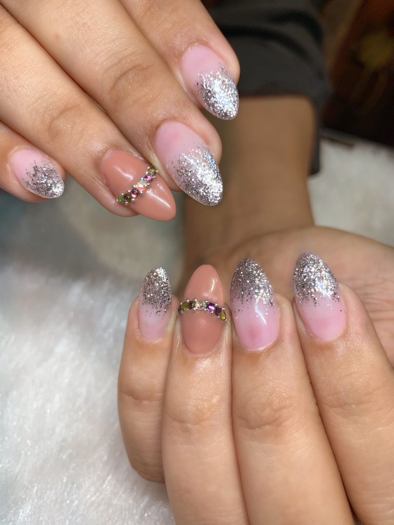 pink nail paint with silver glitter tips and jewels