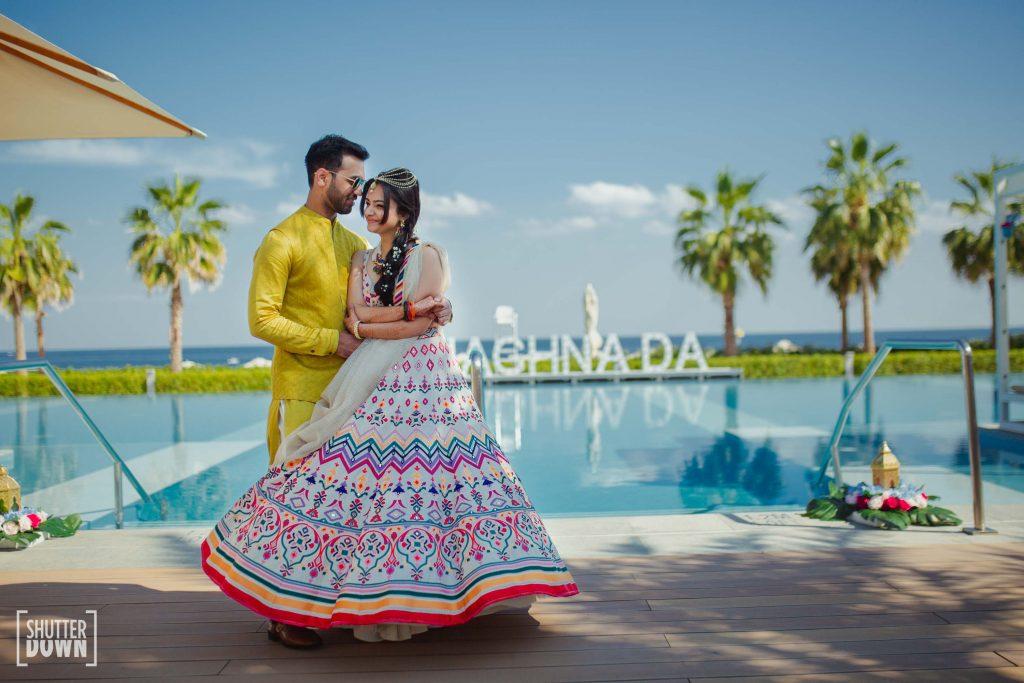 adorable couple poolside photoshoot for moroccan themed mehendi