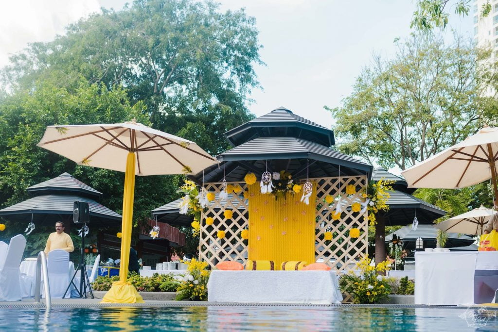 poolside yellow and white haldi function decor for beach wedding in pattaya