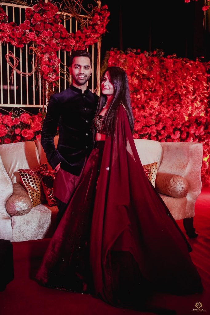 Couple pre wedding reception photoshoot with groom in kurta by Rohit Gandhi and Rahul Khanna and bride in red Manish Malhotra outfit