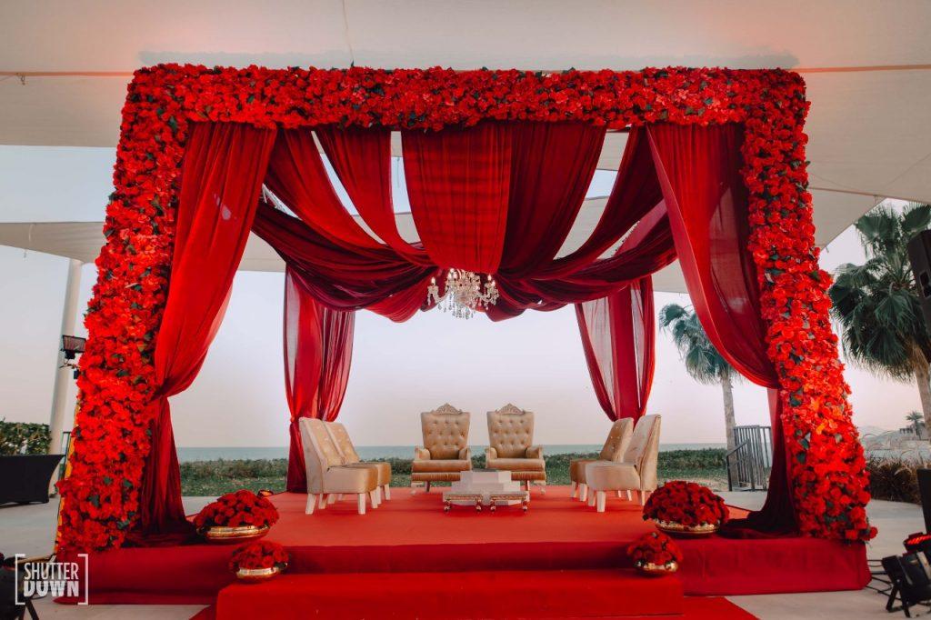beachside red rose themed floral mandap for beach wedding in dubai
