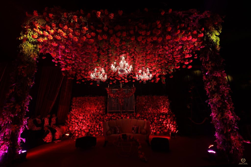 red rose themed pre wedding reception decoration