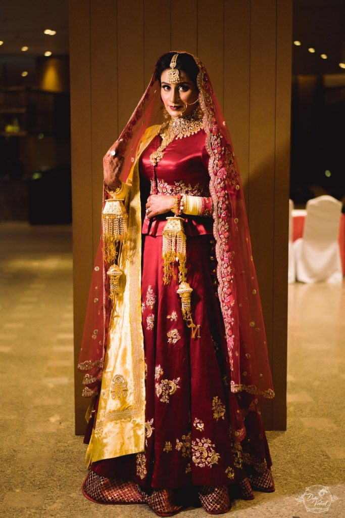 royal red wedding lehenga with golden dupatta