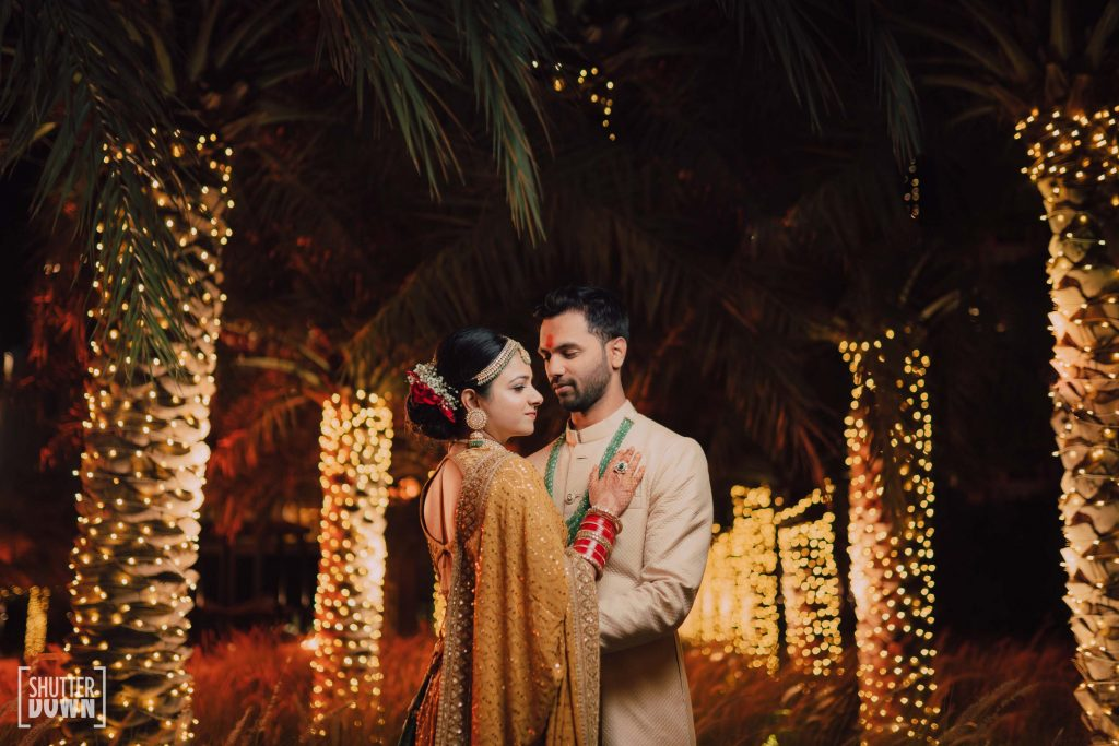 Mrighna & Shallaabh in bridal sabyasachi outfits in Intercontinental Fujairah Resort captured by Ferns and Petals Weddings