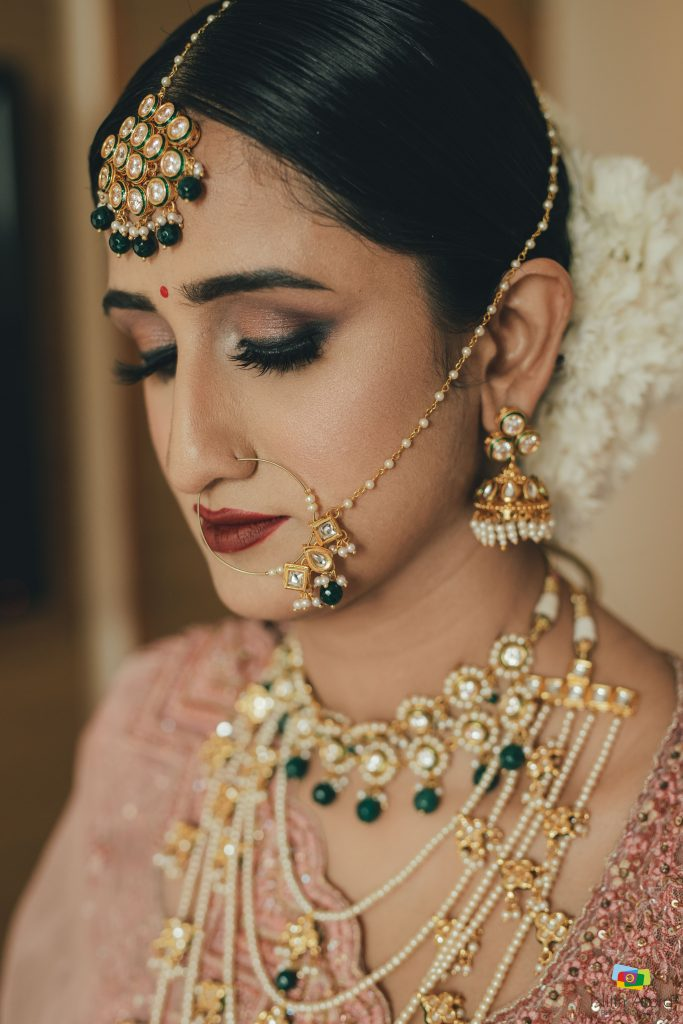 bridal simple copper nude eye makeup look and golden green maang tikka