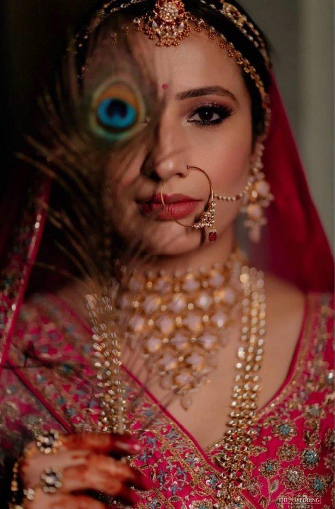 Shika Chandra's rosy pink bridal eye makeup and cat eyeliner
