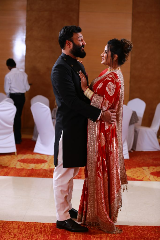 Nikita & Puneet in their beach wedding reception outfits