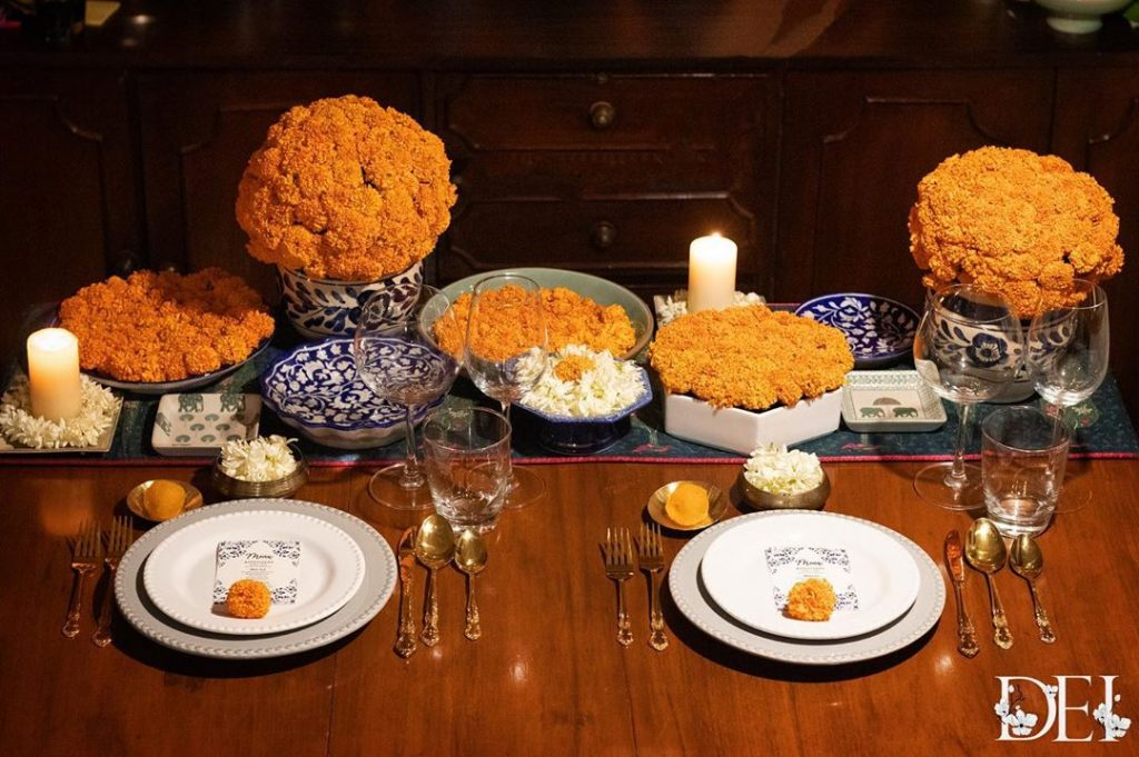 marigold bunches in white porcelain pots for table wear decoration