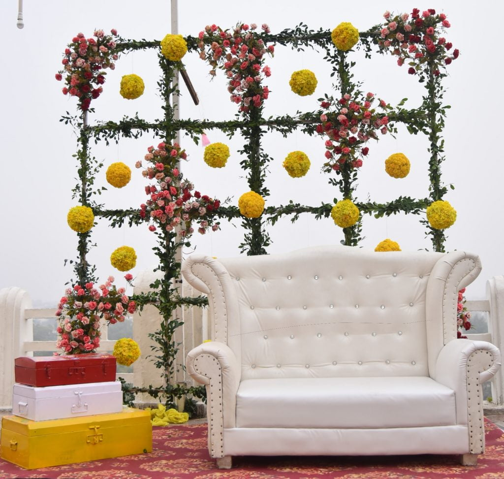 DIY painted trunk decor and aesthetic forest seating backdrop for quirky wedding
