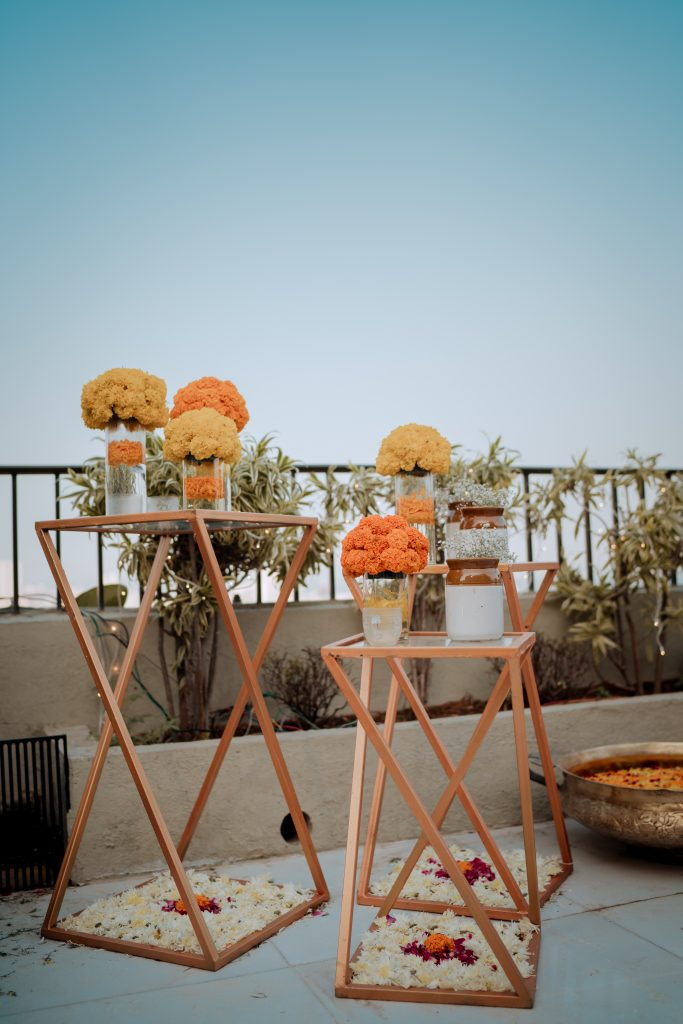 mason jar full of marigolds on a wooden stand