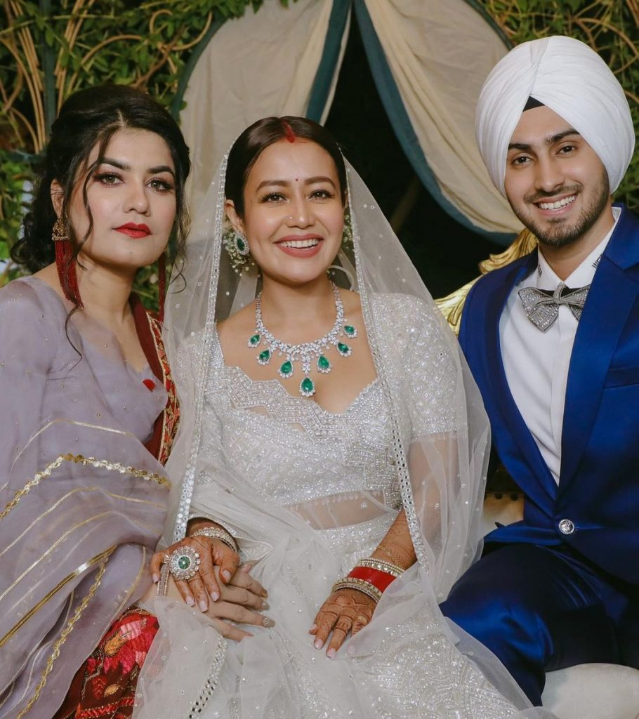 Neha Kakkar and Rohanpreet Posing for a shot with their guest at their wedding reception in Punjab