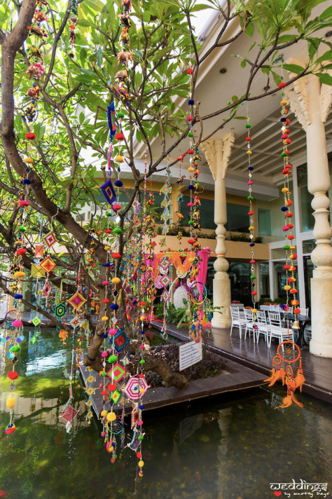 Indian Mehendi function with beautiful colourful hangings for this Dusit Thani Hua Hin Wedding