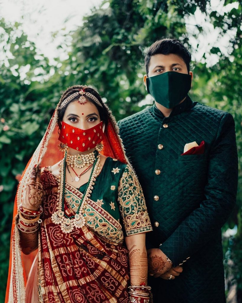 contrasting couple red jeweled and solid dark green face masks
