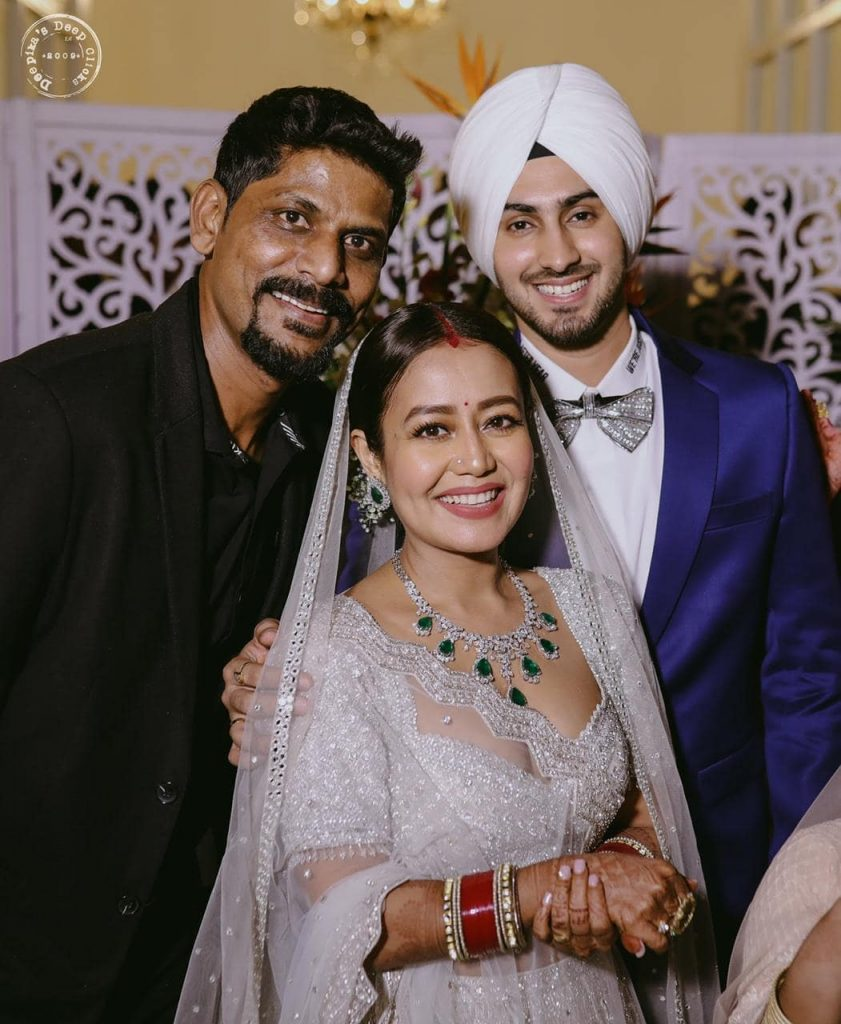 Neha Kakkar and Rohanpreet Singh from their Wedding Reception in Punjab posing for a shot with their guest