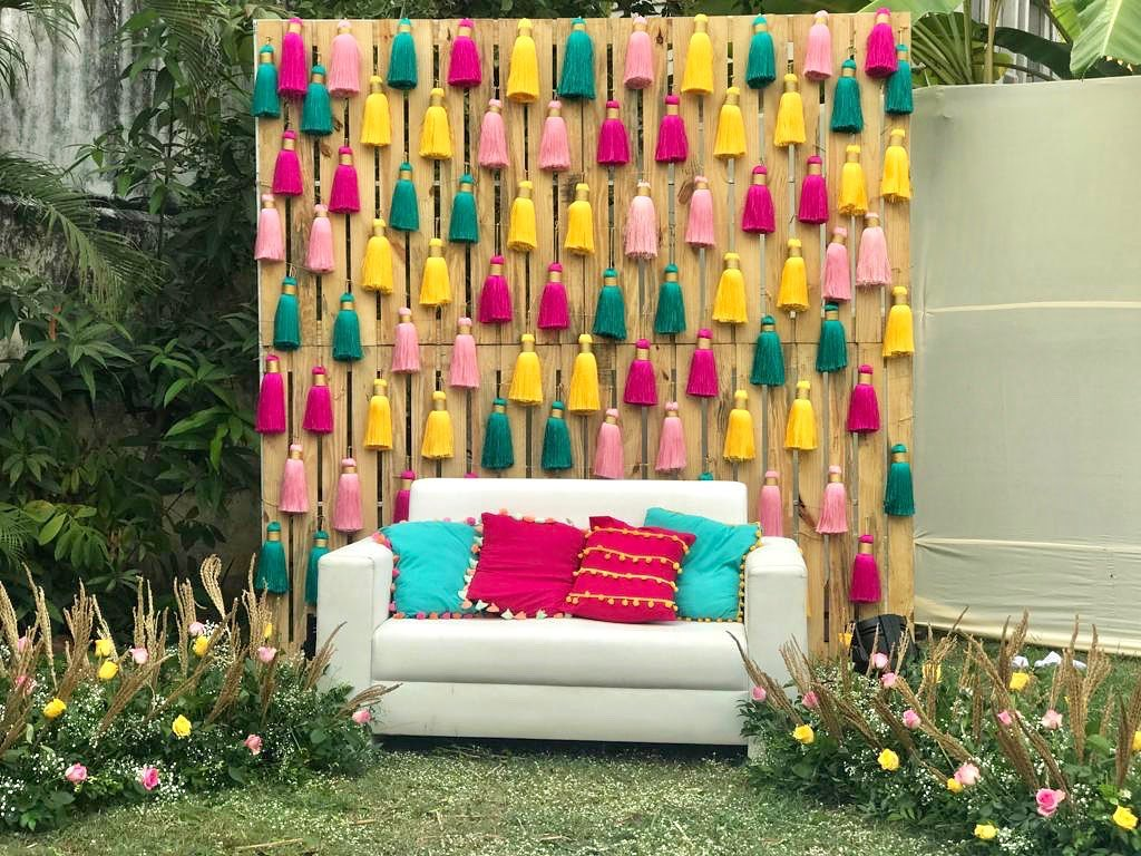 colorful tassel home decor for outdoor seating arrangement