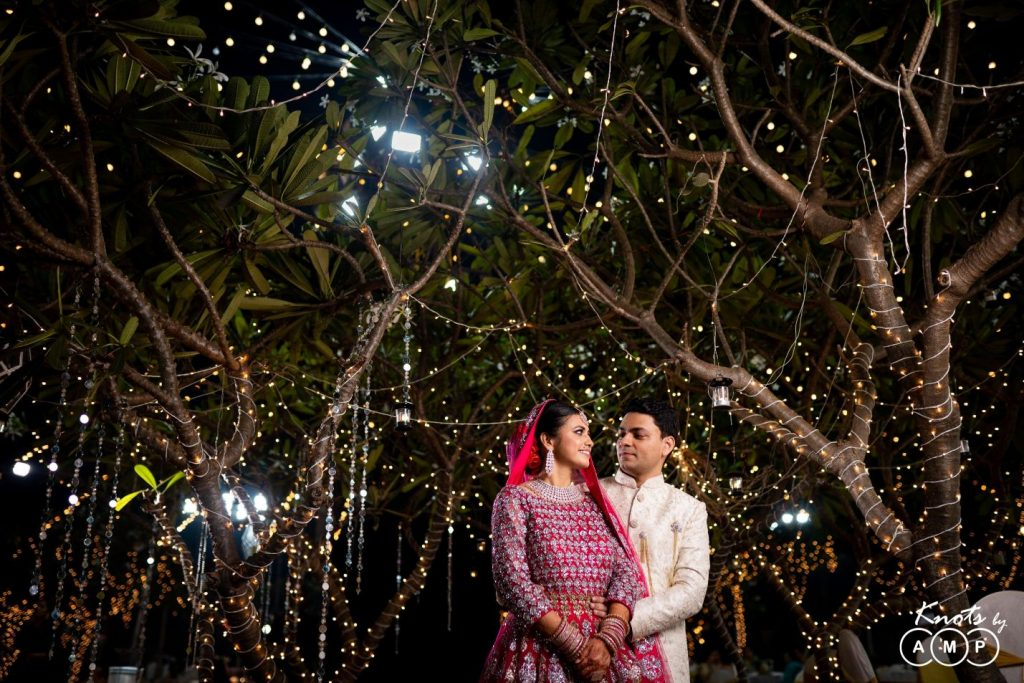 bistro fairy lights on trees for outdoor wedding decor