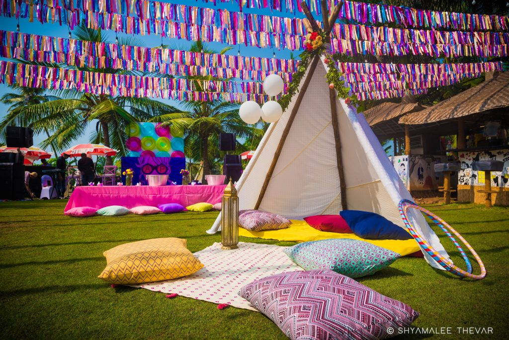 vibrant white canopy guest tent with pillows