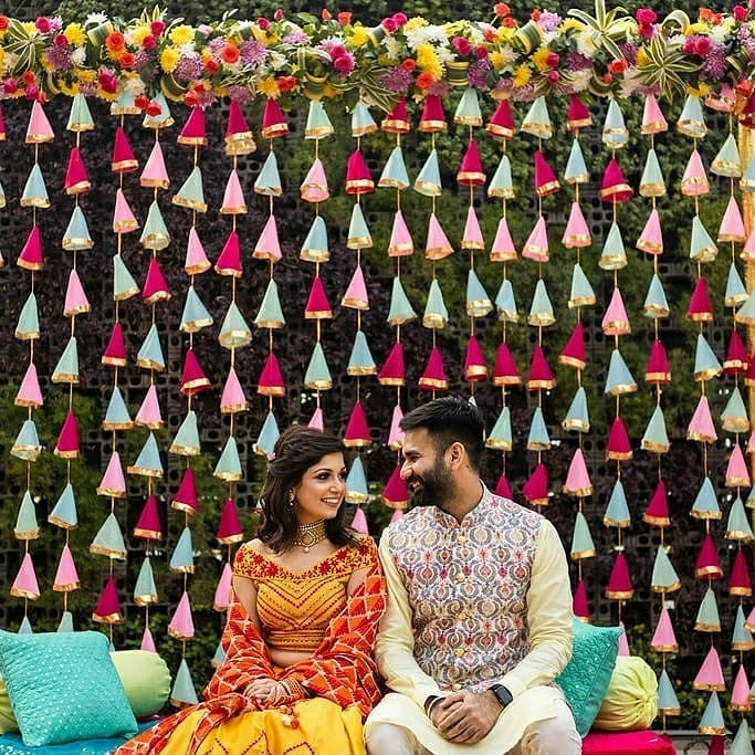 outdoor intimate wedding cloth tassel backdrop with couple posing