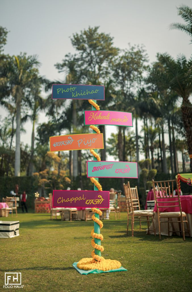 fun outdoor guiding wedding sign post with tags