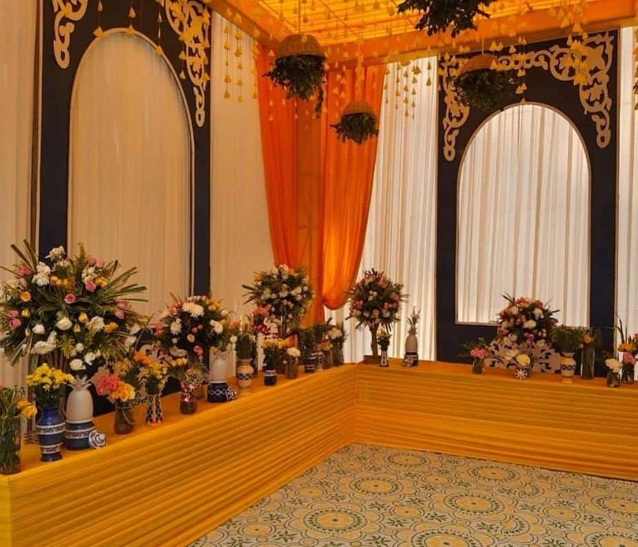bunch floral decoration and vases with drapes for haldi decoration of neha kakkar