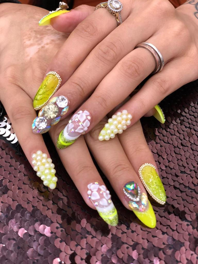 jewel and pearl embedded fancy bridal nail art for indian brides