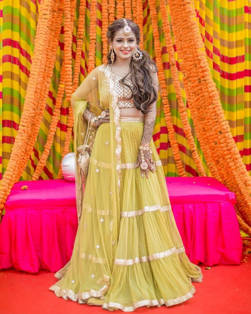 marigold seating arrangement canopy with posing bride