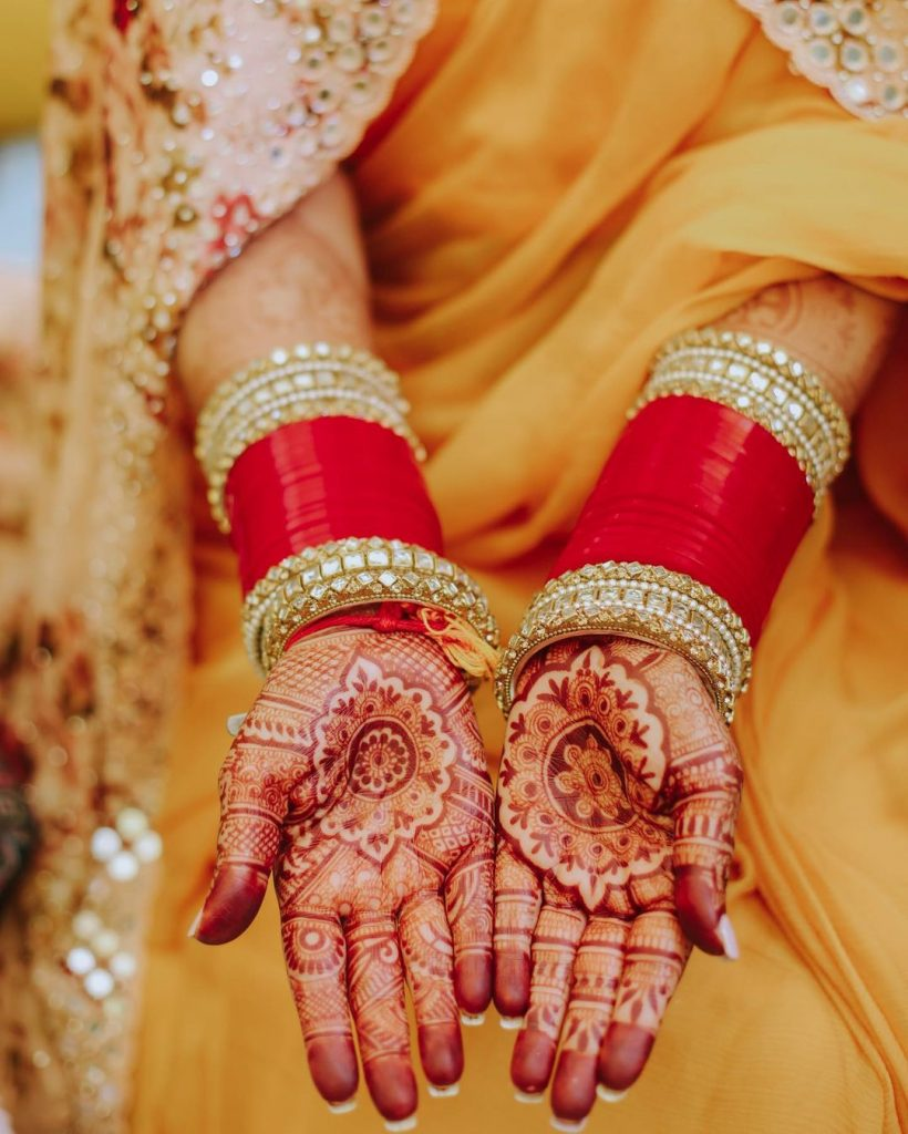 neha kakkar red bangle hands with mehendi for haldi ceremony