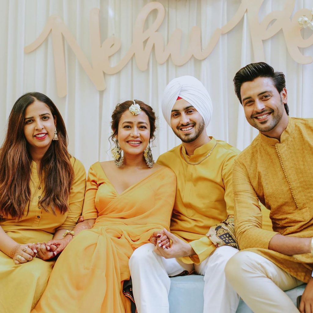 friends posing with neha and rohanpreet for haldi ceremony