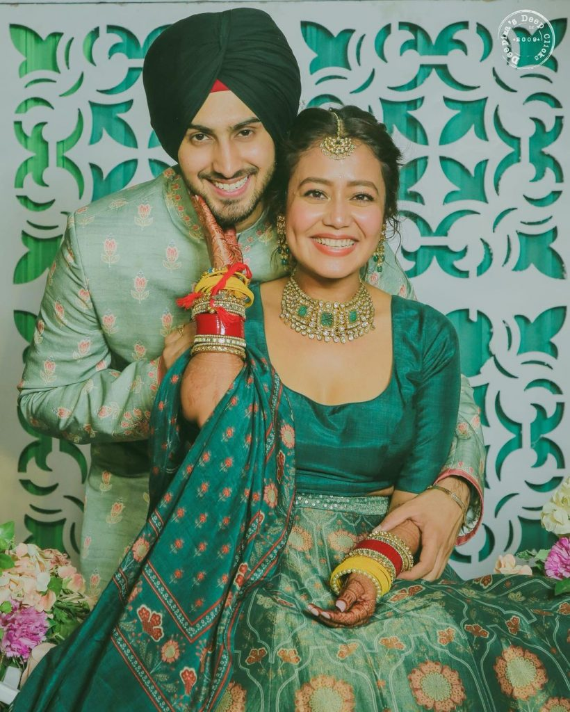 bride neha kakkar and groom rohanpreet posing for mehendi ceremony celebrations