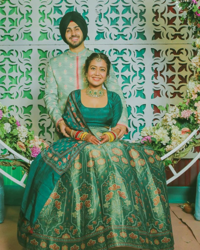 green anita dongre floral mehendi lehenga and groom kurta for neha kakkar wedding