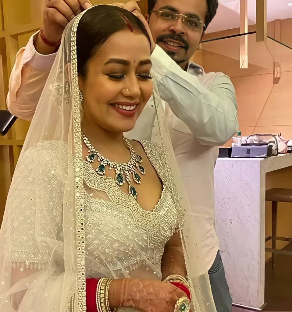 dazzling white neha kakkar wedding reception lehenga