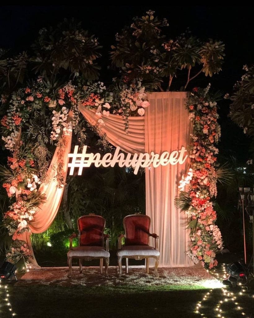 Floral reception decor from neha kakkar wedding with their wedding hashtag #nehupreet