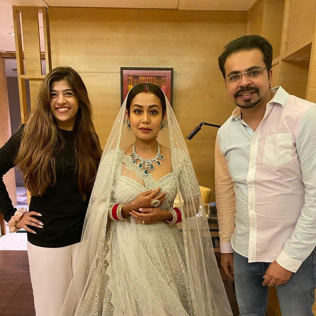 neha posing with reception guests in white lehenga