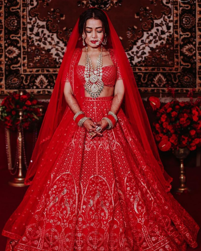 neha kakkar red silver embroidered wedding lehenga