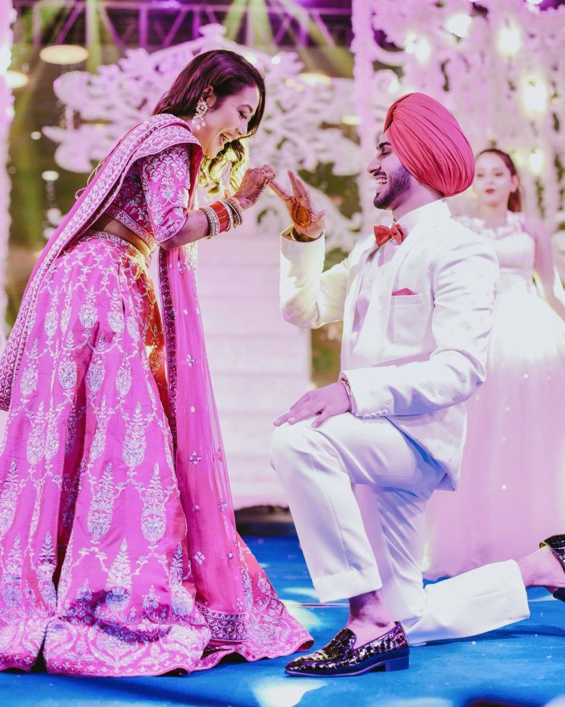 rohanpreet on his knees during ring ceremony with neha kakkar