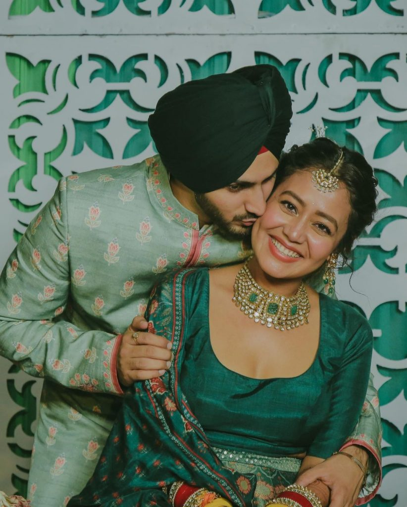 couple neha and rohanpreet in green outfits or mehendi