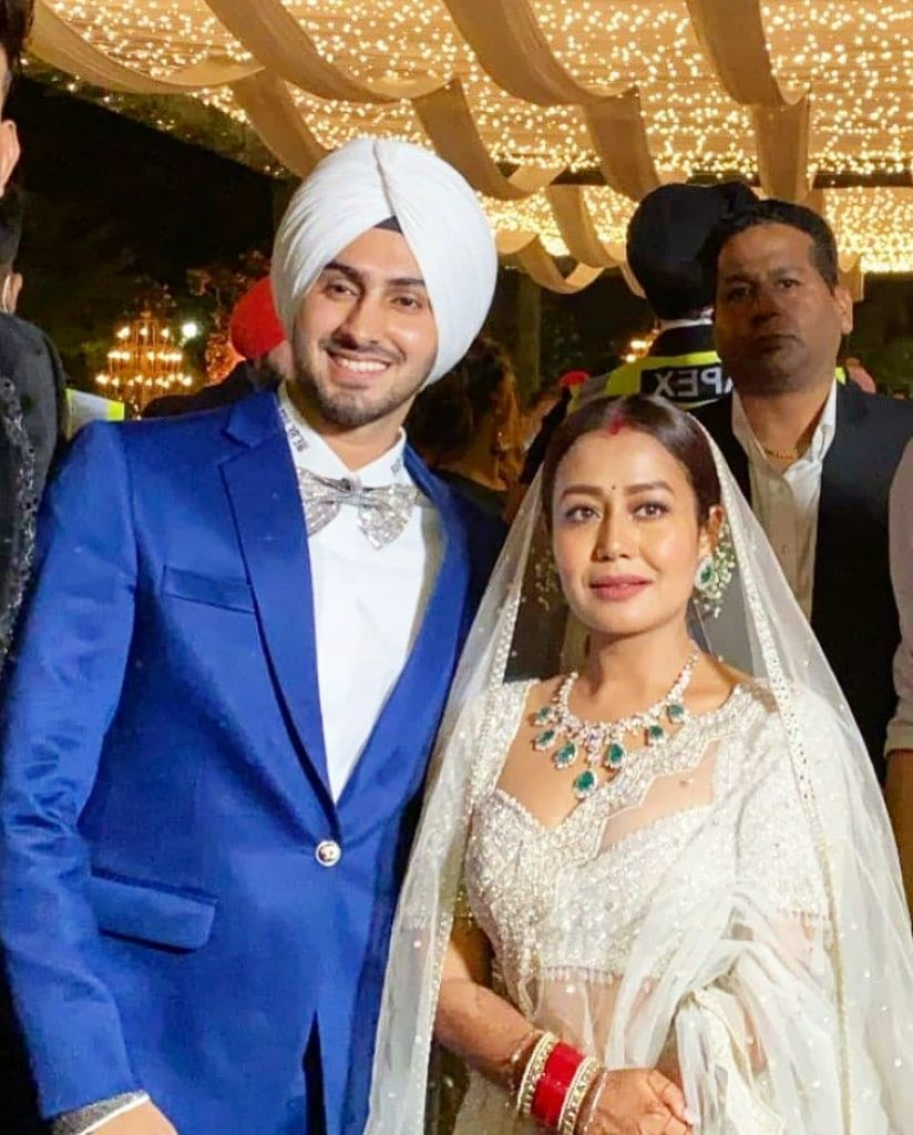 neha and rohanpreet in their Punjab reception with blue coat and white lehenga