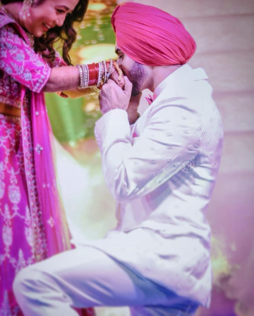 Adorable candid of rohanpreet kissing neha's hands during ring ceremony
