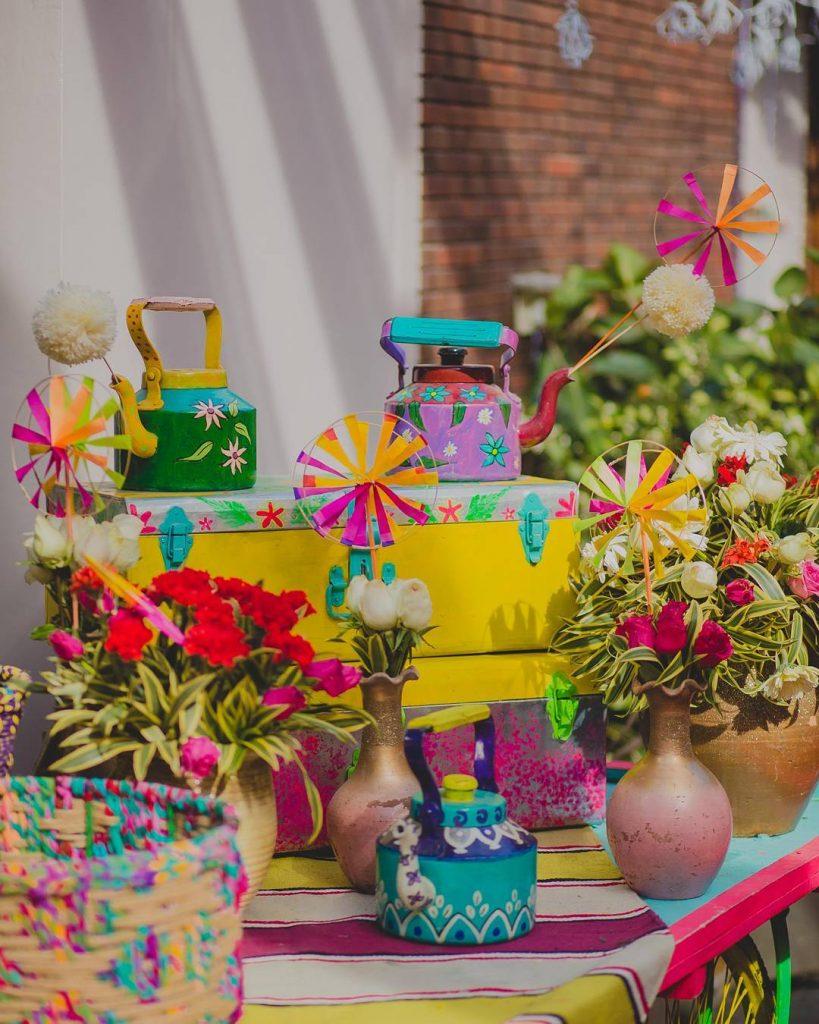 painted quirky teapot and pinwheel Indian home wedding decor