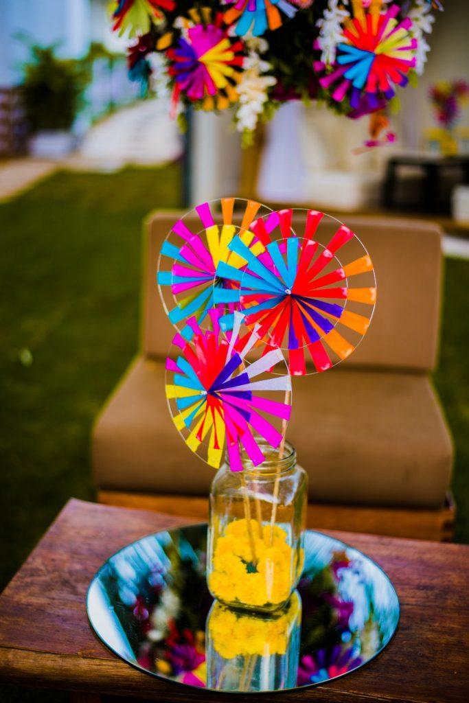 paper pinwheel in a glass jar as centerpiece