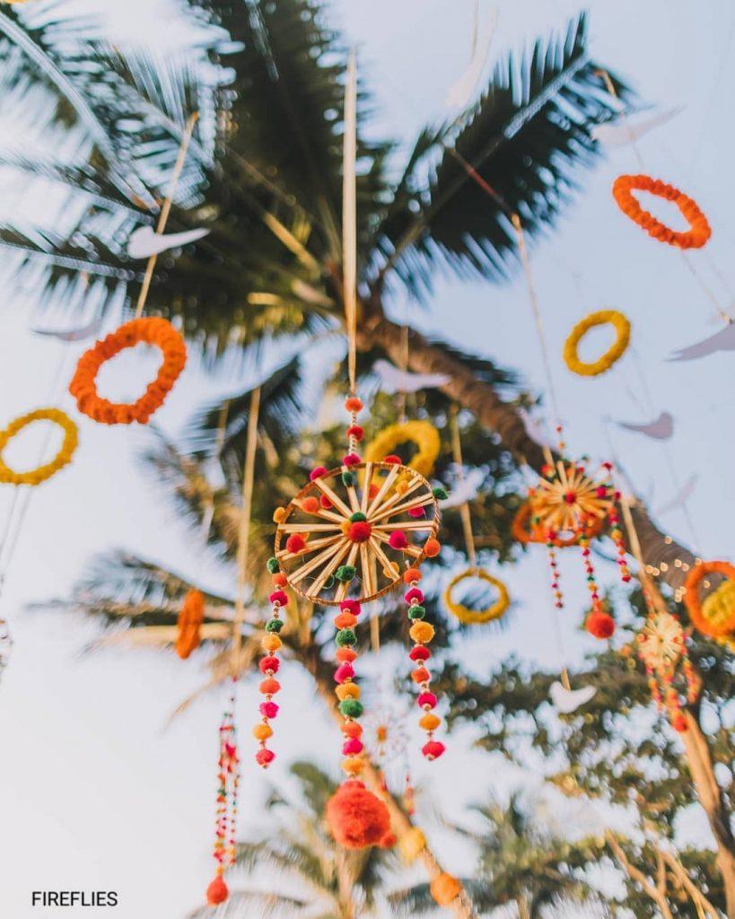 pompoms on wheel hanging outdoor wedding decor