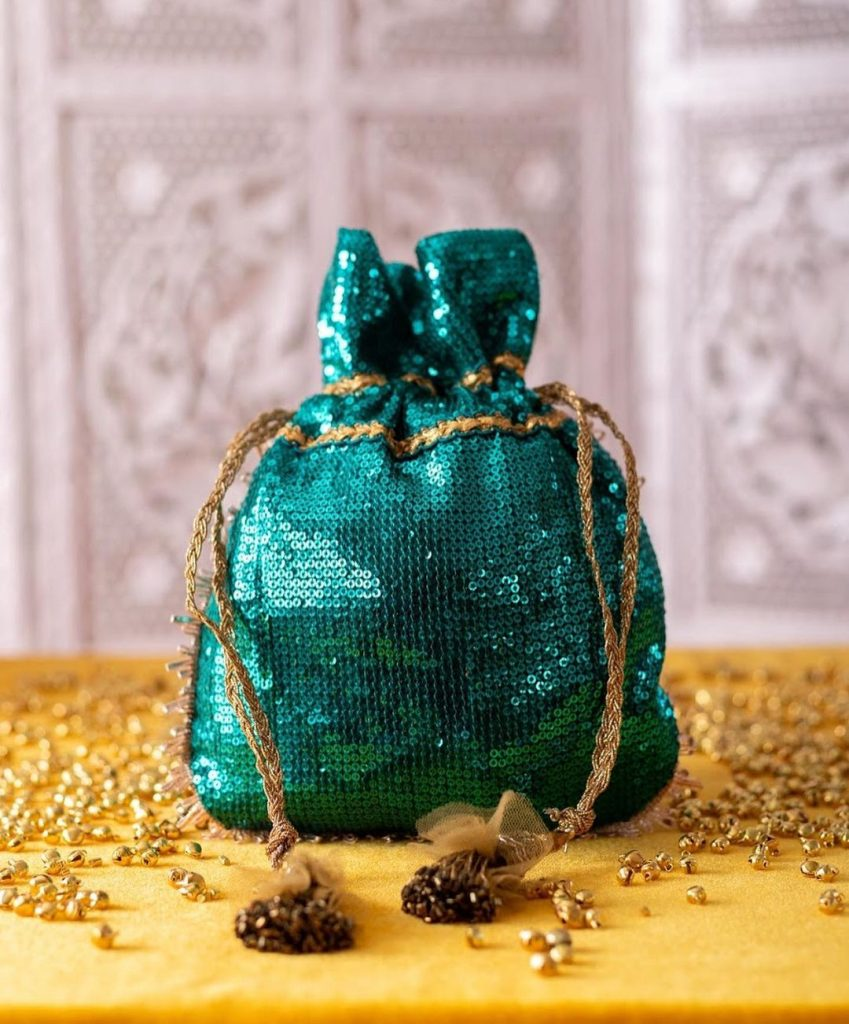 green colored sequin sachet for neha kakkar wedding by Pataaree
