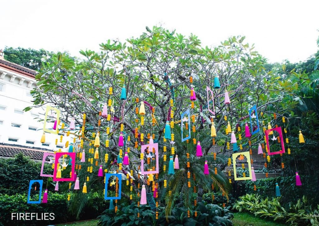 DIY tassels hanging down from an outdoor wedding tree