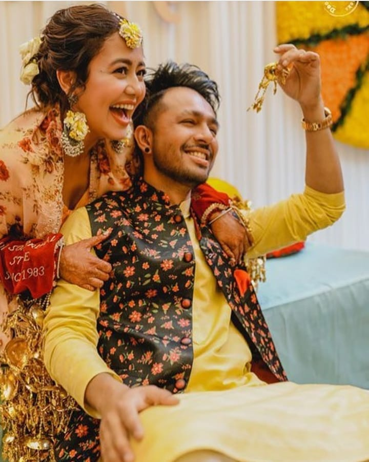 tony and neha kakkar posing during haldi function