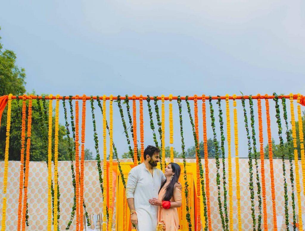 simple marigold hanging as intimate wedding decor